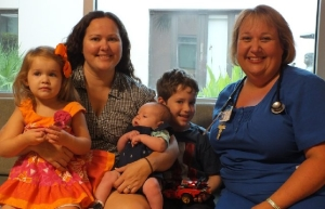 SGHS mother with children and nurse